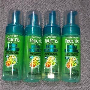 4 bottles Garnier Fructis leave-in conditioner